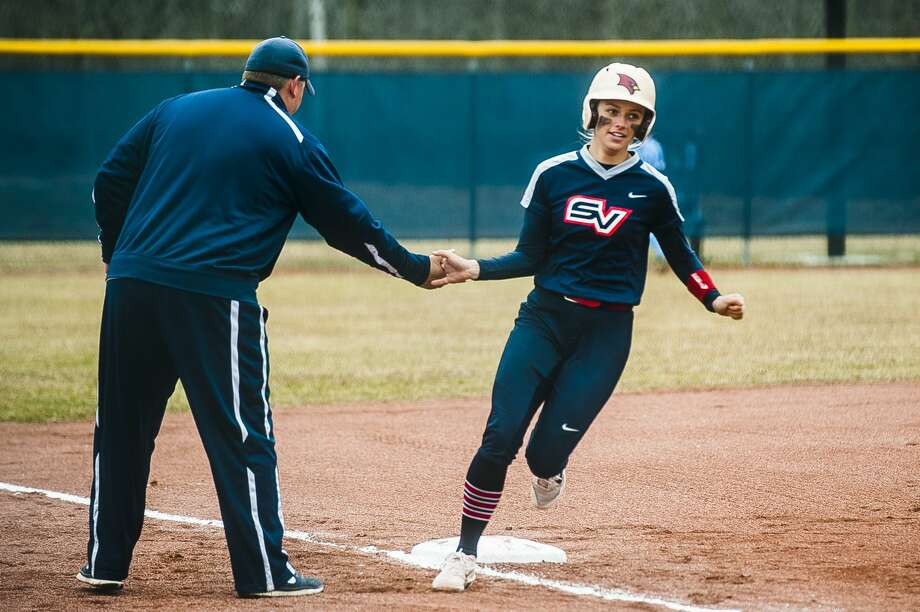 Saginaw Valley State senior Meredith Rousse high fives one of her coaches while scoring a home run during the Cardinals' game against Northwood on Thursday, March 29, 2018 at Northwood University. (Katy Kildee/kkildee@mdn.net) Photo: (Katy Kildee/kkildee@mdn.net)
