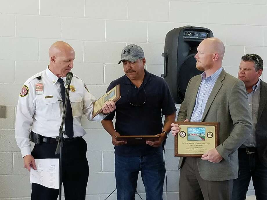 When the fire department station project was first put out to bid, the City of Conroe awarded the contract for Construction Manager at Risk responsible for the construction of the station and the Fire Training Facility. During the course of construction, Clifford Hyde, the superintendent for the project, died in September 2017 before he could see the completion of the project. In turn, his partners at Christensen Building Group received plaques honoring Hyde and his team for their hard work and presented a plaque for Hyde's widow.
