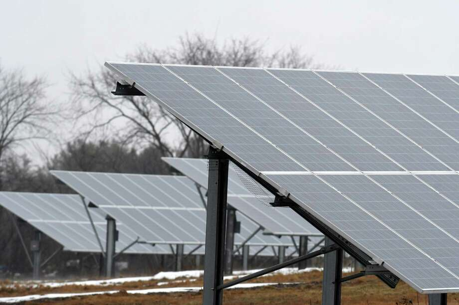 Solar panels in a five-acre field on Route 7 are part of a community solar farm on Thursday, March 29, 2018, in Pittstown, N.Y. The Monolith Solar farm supplies power to support the Albany City School District, with the remaining electricity earmarked for 26 homeowners or apartment dwellers throughout the Capital Region. (Will Waldron/Times Union) Photo: Will Waldron, Albany Times Union
