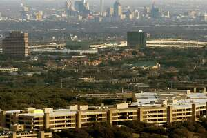 USAA announced Thursday it's selling a controlling stake in USAA Real Estate Co. to the latter's current management and a private investment group. The USAA headquarters building, with downtown San Antonio in the background, is seen in a Feb. 1, 2018 aerial photo.