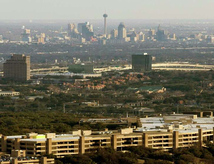 The USAA headquarters building, with downtown San Antonio in the background, in an aerial photo taken last month.