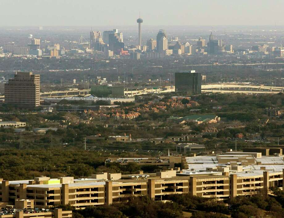 San Antonio based financial services company is cutting 53 jobs at its headquarters following the planned sale of USAA Asset Management Co. The USAA headquarters building, with downtown San Antonio in the background, is seen in a Feb. 1, 2018, aerial photo. Photo: William Luther /Staff File Photo / © 2018 San Antonio Express-News