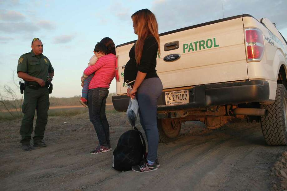 An immigrant from El Salvador, seven months pregnant, she said, stands next to a U.S. Border Patrol truck after she and others turned themselves in to border agents on December 7, 2015 near Rio Grande City, Texas. Many pregnant women, according to Border Patrol agents, cross illegally into the U.S. late into their terms with the intention of birthing their babies in the United States. All people born in the U.S. are American Citizens, according to the U.S. constitution. Border Patrol agents continue to detain hundreds of thousands of undocumented immigrants trying to avoid capture after crossing into the United States, even as migrant families and unaccompanied minors from Central America cross and turn themselves in to the Border Patrol to seek assylum.  (Photo by John Moore/Getty Images) Photo: John Moore, Staff / Getty Images / 2015 Getty Images