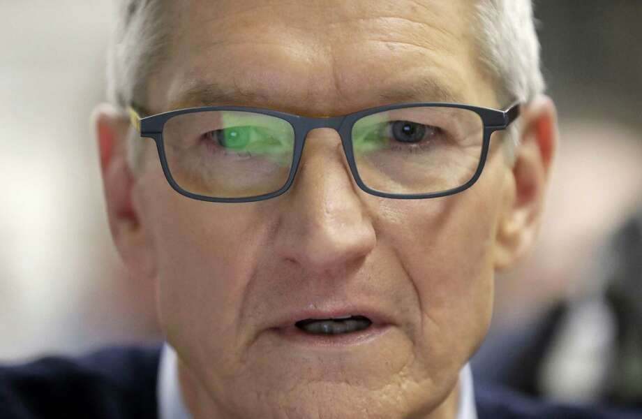 Apple CEO Tim Cook watches a demonstration of an App on the new educational Apple iPad during an Apple event at Lane Technical College Prep High School Tuesday. Photo: Charles Rex Arbogast, STF / Associated Press / Copyright 2018 The Associated Press. All rights reserved.