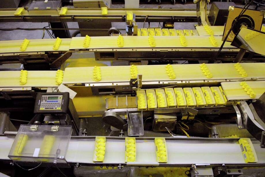 Peeps Chicks move down a conveyor belt to be boxed and shipped at the Just Born manufacturing facility in Bethlehem, Pa. Photo: Bloomberg Photo By Mike Mergen / Bloomberg
