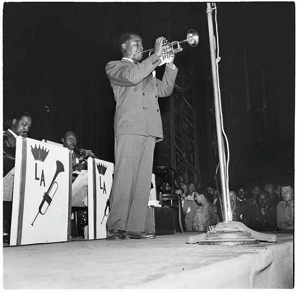 Trumpet player Louis Armstrong and his band played Seattle's Civic Auditorium on July 17 and 18, 1944. Many of his fans at the edge of the stage are in the military. Courtesy of MOHAI, Al Smith Collection, 2014.49.002-027-0094