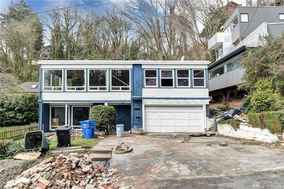 This Leschi home, an extreme fixer or total teardown, asks $899K Photo:  James Melgard • Christopher Nelson • Windermere Real Estate/East