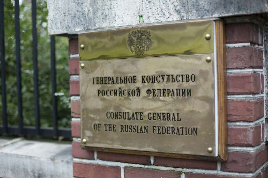 A sign is displayed outside the residence of the Russian consulate stands in Seattle, on Monday. President Donald Trump ordered 60 Russian diplomats the U.S. considers spies to leave the country and closed the consulate in response to the nerve-agent attack on a former Russian spy in the U.K., as European allies and Canada took similar measures. Must credit: Bloomberg photo by David Ryder Photo: David Ryder, Bloomberg / © 2018 Bloomberg Finance LP