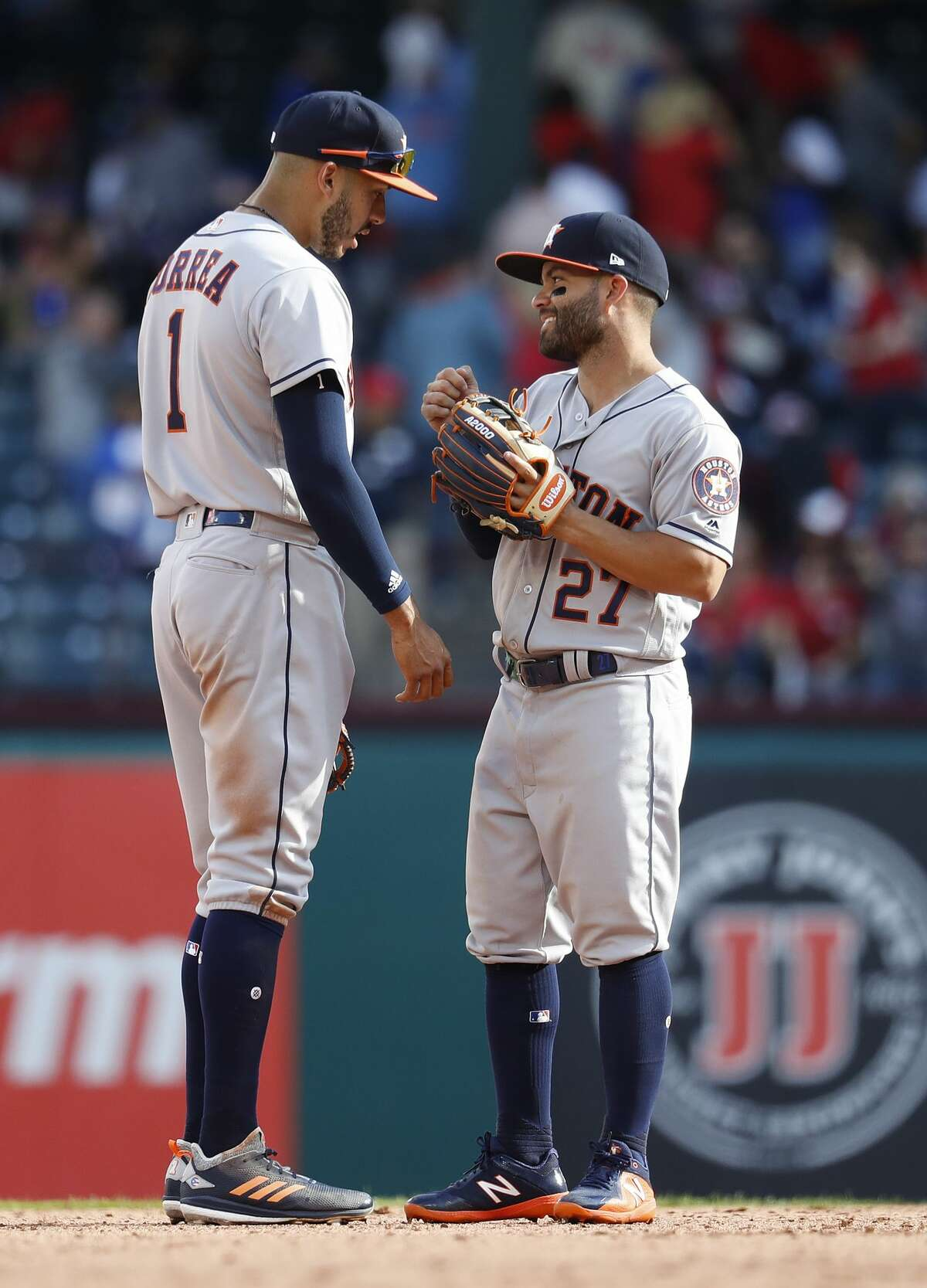 Houston Astros shortstop Carlos Correa (1) with Jose Altuve (27) on the field in the ninth inning of Opening Day at Globe Life Park, Thursday, March 29, 2018, in Arlington. ( Karen Warren / Houston Chronicle )