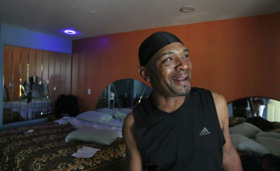 Jonathan Ardion, 50, makes a joke about the light fixture in his second floor room at Almeda Inn while talking about his living situation on Thursday, March 29, 2018, in Houston. Ardion and his nephew, Andre Ardion, 33, had been staying at the hotel after Hurricane Harvey damaged their homes. Photo: Yi-Chin Lee / Houston Chronicle / © 2018 Houston Chronicle