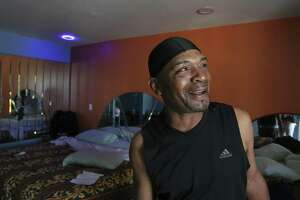 Jonathan Ardion, 50, makes a joke about the light fixture in his second floor room at Almeda Inn while talking about his living situation on Thursday, March 29, 2018, in Houston. Ardion and his nephew, Andre Ardion, 33, have been staying at the hotel after Hurricane Harvey damaged their homes and they are expected to move out of the hotel on Monday, April 2. ( Yi-Chin Lee / Houston Chronicle )