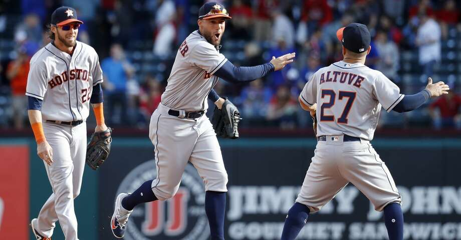 Houston Astros George Springer (4) lcelebrates the Astros 4-1 win over the Rangers with Jose Altuve (27) and Josh Reddick (22) after the final out of the ninth inning of  Opening Day at Globe Life Park, Thursday, March 29, 2018, in Arlington.   ( Karen Warren / Houston Chronicle ) Photo: Karen Warren/Houston Chronicle
