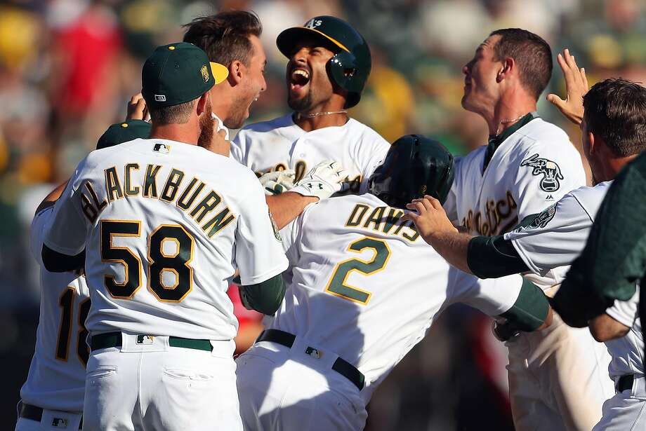 Oakland Athletics' Marcus Semien celebrates his game-winning RBI during A's 6-5 win over Los Angeles Angels in 11 innings in MLB game at Oakland Coliseum in Oakland, Calif., on Thursday, March 29, 2018. Photo: Scott Strazzante / The Chronicle