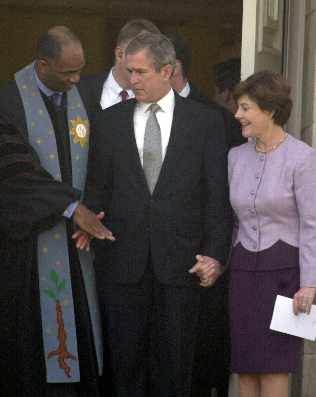 Windsor Village-St John's United Methodist Churches Pastor Kirbyjon H. Caldwell, of Houston, greets George W. Bush and Laura Bush after a prayer service at Tarrytown United Methodist Church Thursday, Dec. 14, 2000, in Austin.