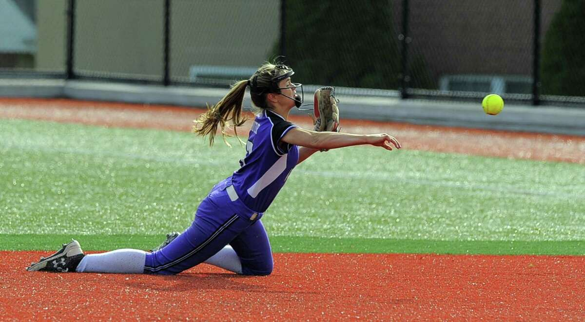 Westhill's Olivia Butler tosses the ball to first base for the out in the first inning against Darien during the FCIAC girls softball championship at Sacred Heart University in Fairfield on May 24, 2017. Butler returns to lead Westhill.