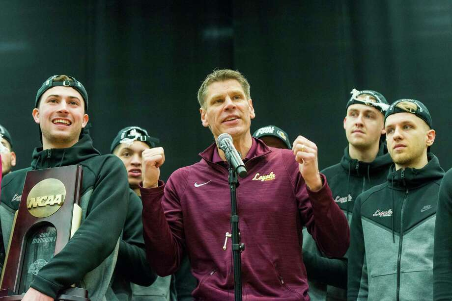 Loyola head coach Porter Moser, addresses fans at the Ramblers rally inside the Gentile Arena, Sunday, March 25, 2018 in Chicago. The nation's hottest team in the tournament is heading to the Final Four, and Loyola's dominating performance in its latest victory is the strongest evidence yet that the Ramblers belong. (Tyler LaRiviere/Chicago Sun-Times via AP) Photo: Tyler LaRiviere, Associated Press / Sun-Times 2018