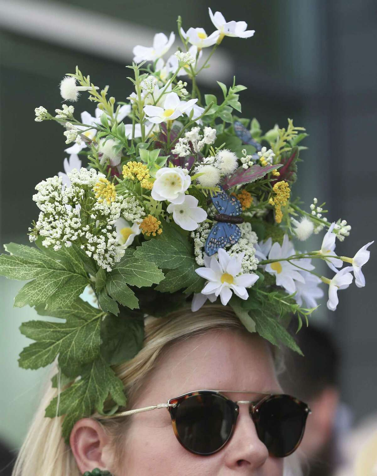Guests wear spring-themed hats to the Hats in the Park luncheon at the Cherie Flores Garden Pavilion.