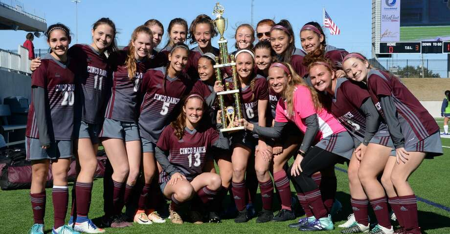 The Cinco Ranch team poses with the Cougar Bracket  championship trophy of the I-10 Shootout after defeating the Pearland Oilers by a score of 3-2 on Saturday January 13, 2018 at Legacy Stadium, Katy, TX. Photo: Craig Moseley/Houston Chronicle