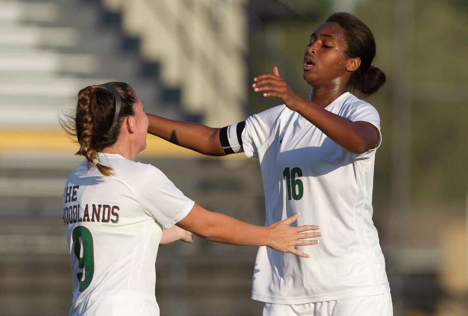 The Woodlands forward Jazzy Richards (16) reacts with forward Aliyah Hale (9) after scoring her second goal of the first period during a Region II-6A bi-district playoff match at Nacogdoches High School, Thursday, March 29, 2018, in Nacogdoches. Photo: Jason Fochtman, Staff Photographer / © 2018 Houston Chronicle