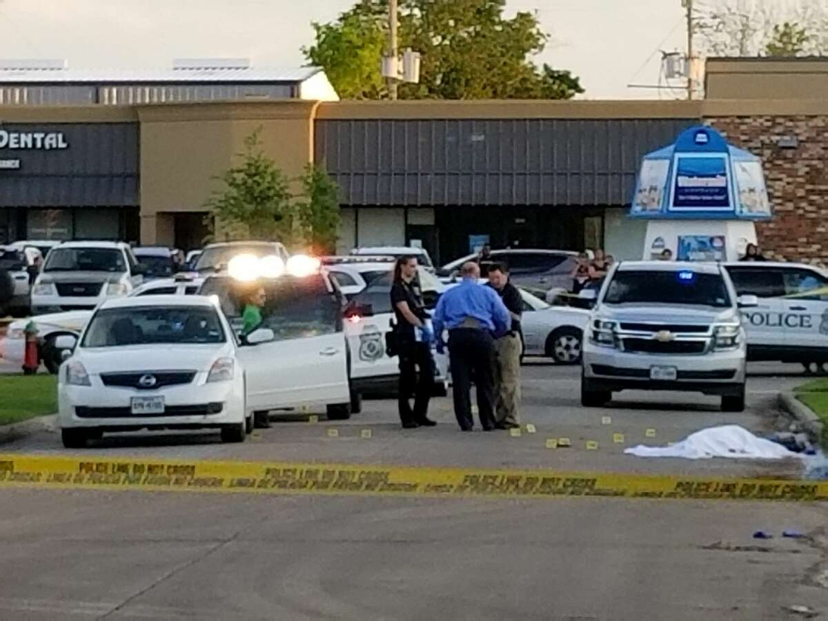 A Pasadena police officer opened fire on an armed suspect Thursday afternoon following a half-mile pursuit, officials said. (Jose Gonzalez/ Houston Chronicle)