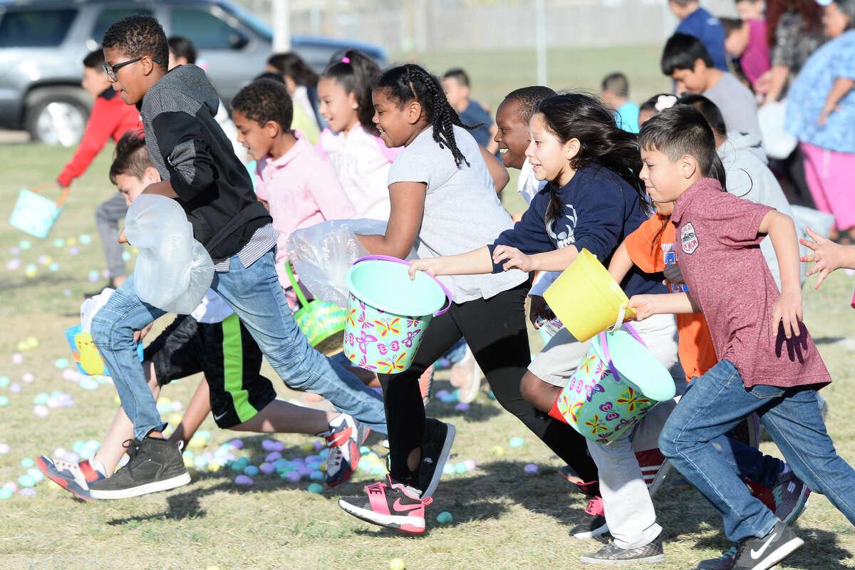 "Children gather easter eggs during the City of Midland's ""Easter Eggstravaganza"" March 29, 2018, at MLK Park. James Durbin/Reporter-Telegram"