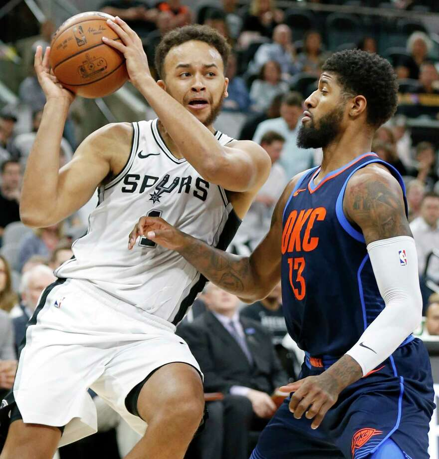 San Antonio SpursÕ Kyle Anderson looks for room around Oklahoma City Thunder's Paul George during first half action Thursday March 29, 2018 at the AT&T Center. Photo: Edward A. Ornelas, San Antonio Express-News / © 2018 San Antonio Express-News