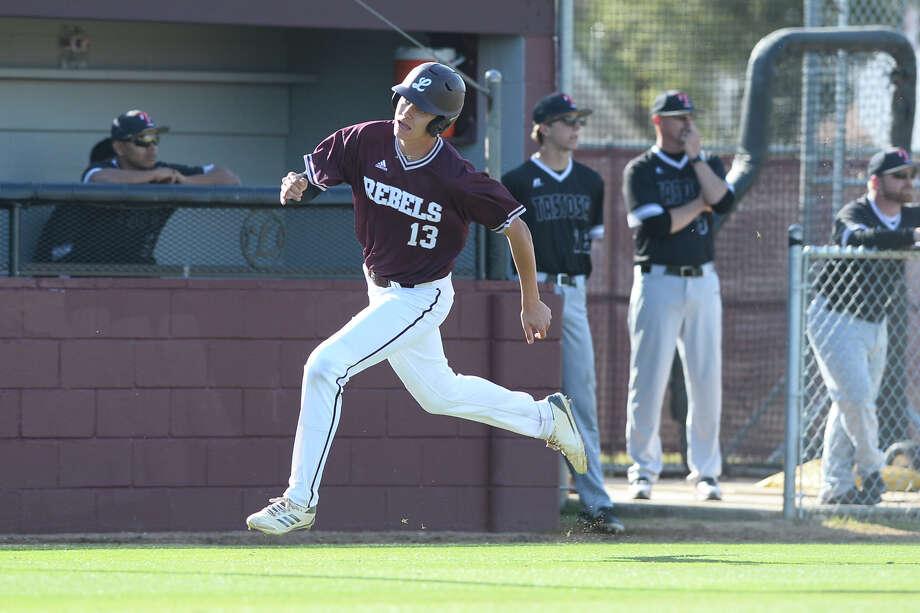Lee's Tyler Madrid (13) runs home to score against Amarillo Tascosa March 29, 2018, at Ernie Johnson Field. James Durbin/Reporter-Telegram Photo: James Durbin