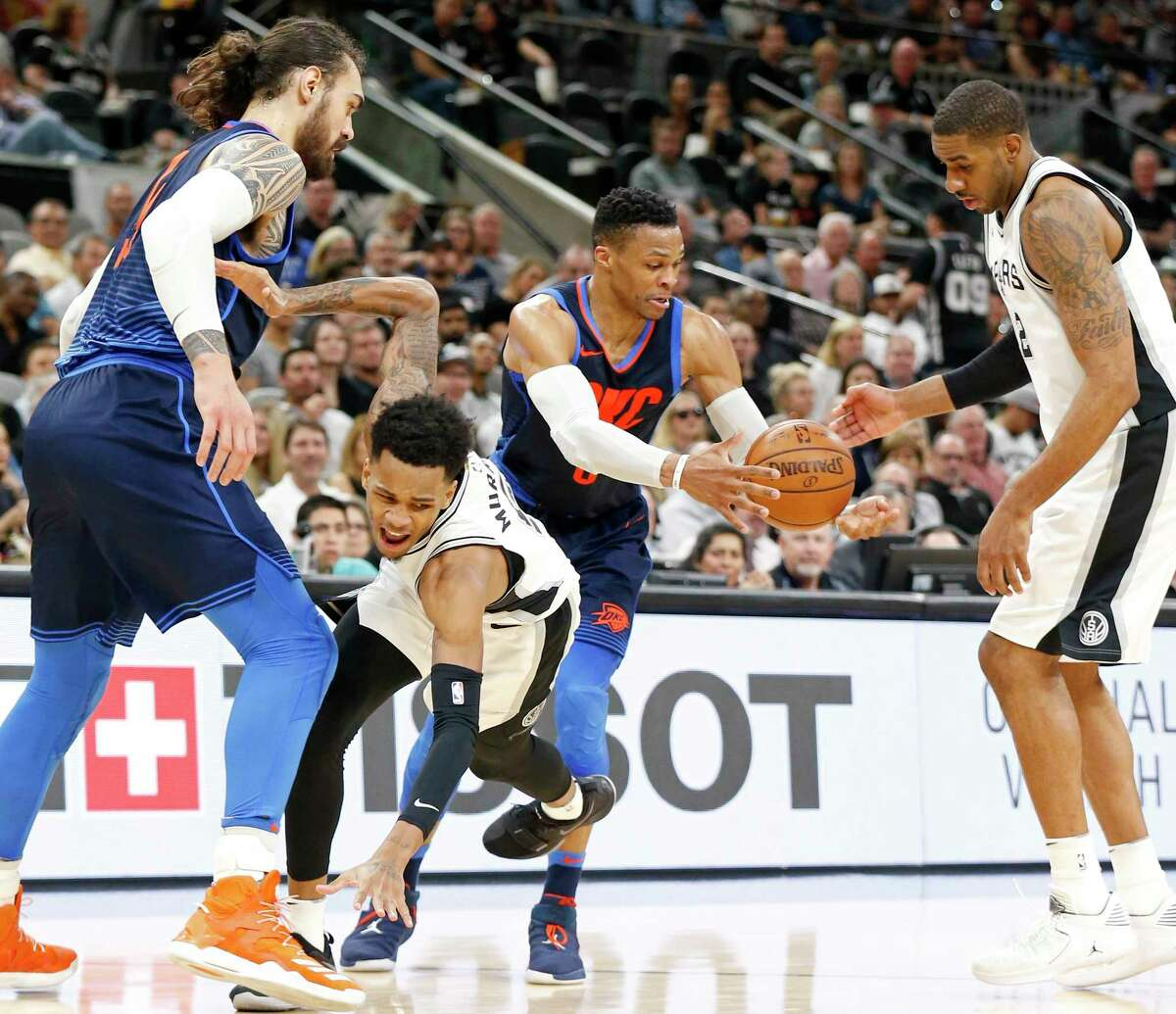 Oklahoma City Thunder's Steven Adams (from left), San Antonio Spurs' Dejounte Murray, Oklahoma City Thunder's Russell Westbrook and San Antonio Spurs' LaMarcus Aldridge chase after a loose ball during first half action Thursday March 29, 2018 at the AT&T Center.