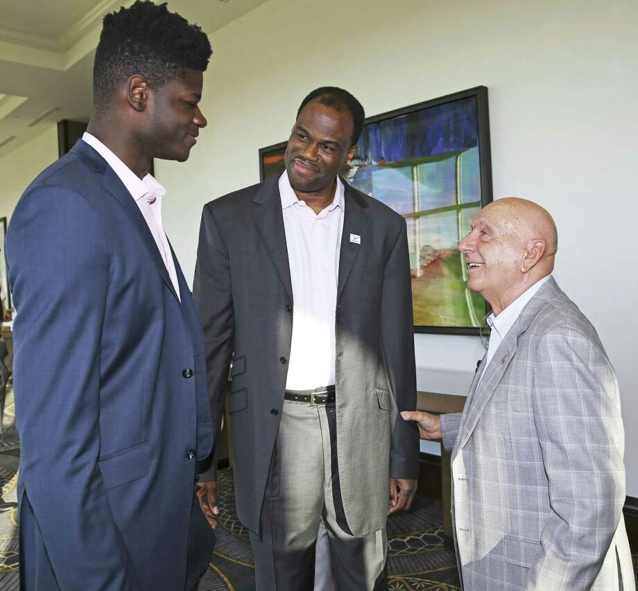 UT center Mo Bamba (left) talks with David Robinson and Dick Vitale as Robinson is appointed as board member of the V Foundation on Thursday in at a fundraiser at La Cantera Resort. Photo: Tom Reel /San Antonio Express-News / 2017 415916Z.1 ANTONIO EXPRESS-NEWS