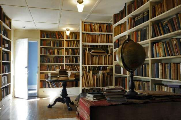 Nobody was allowed in Edna St. Vincent Millay?s book-lined private library, not even her husband, where she made her intentions clear by hanging a handmade sign from the ceiling that read, ?SILENCE.? ( Philip Kamrass / Times Union) Photo: PHILIP KAMRASS