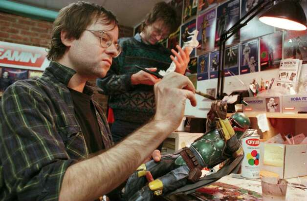 In this March 1997 photo, Chris Ryan, (foreground)  staff artist of Screamin' Products Inc. in Albany, paints a scale model of a Boba Fett figure from the Stars Wars movies. Ryan was stabbed to death in 1999. (Paul Buckowski / Times Union) Photo: PAUL BUCKOWSKI / ALBANY TIMES UNION