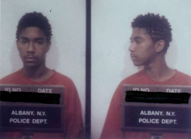 Eric Neal White, now 27, of Albany, is photographed in a mug shot  taken in 1999 when he was a suspect in the Washington Park murder of 33-year-old Christopher Ryan. (File photo) Photo: HAND OUT / ALBANY TIMES UNION