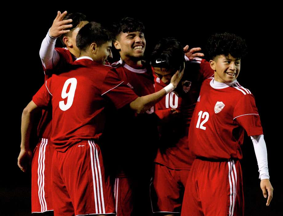 Caney Creek's Omar Quintana celebrates with teammates after scoring a goal in the first period of a match during the Willis Wildkat Showcase at Lynn Lucas Middle School, Thursday, Jan. 4, 2018, in Willis. Photo: Jason Fochtman, Staff Photographer / © 2018 Houston Chronicle