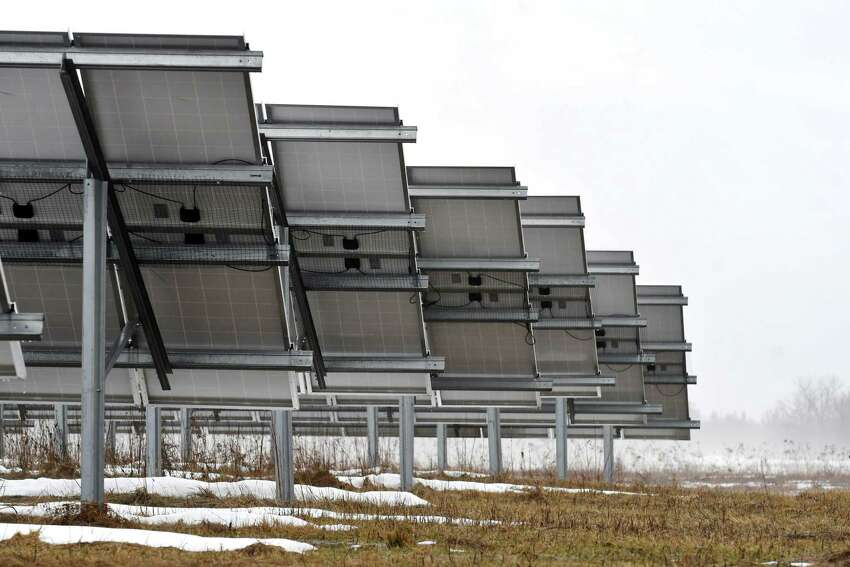 Solar panels in a five-acre field on Route 7 are part of a community solar farm on Thursday, March 29, 2018, in Pittstown, N.Y. (Will Waldron/Times Union)