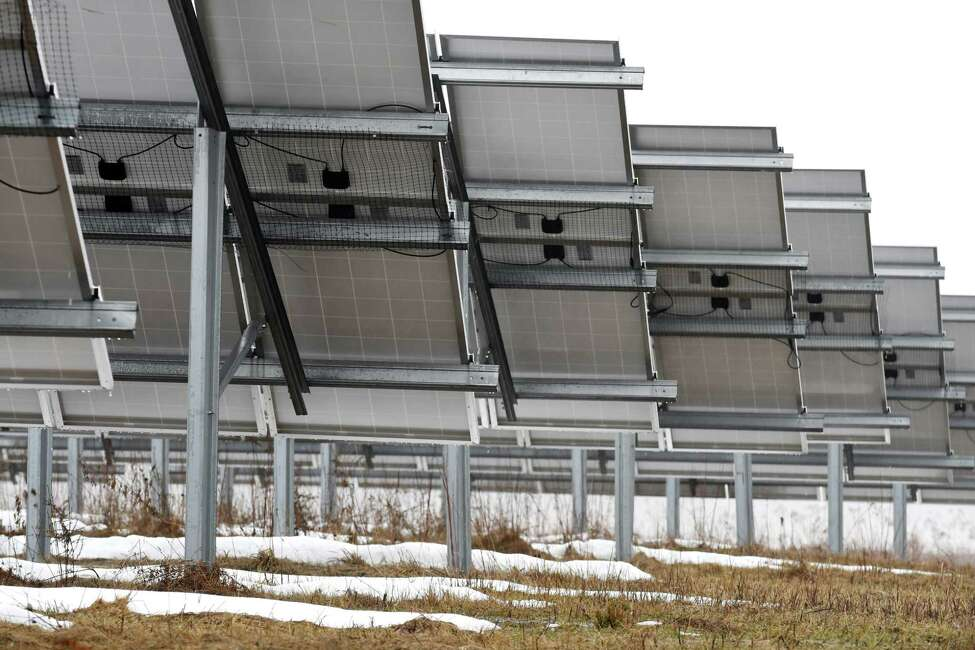 Solar panels in a five-acre field on Route 7 are part of a community solar farm on Thursday, March 29, 2018, in Pittstown, N.Y. The Monolith Solar farm supplies power to support the Albany City School District, with the remaining electricity earmarked for 26 homeowners or apartment dwellers throughout the Capital Region. (Will Waldron/Times Union)