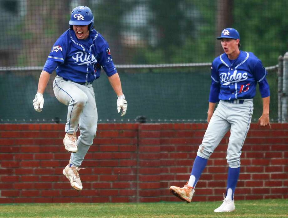 Oak Ridge's Chase Roberts, left, reacts alongside starting pitcher Trey Valka after Logan Letney's three-runer homer off Conroe starting pitcher Colton Debowski during the third inning of a District 12-6A high school baseball game on Tuesday, March 27, 2018, in Conroe. ( Brett Coomer / Houston Chronicle ) Photo: Brett Coomer, Staff / © 2018 Houston Chronicle