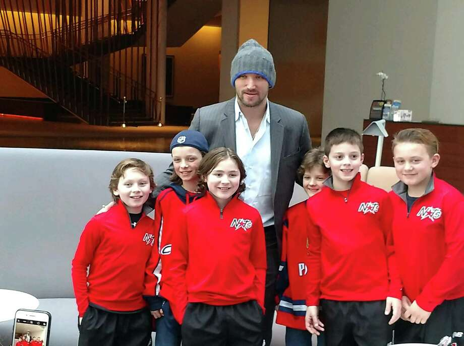 Members of the Albany Capitals youth hockey team got to meet with Russian NHL star Alex Ovechkin of the Washington Capitals after a practice Monday, March 26, 2018, in New York. Players pictured (from left) are Gavin Parks (Syracuse), Kyril Morgoslepov (Saratoga Springs), Emmitt Porter (Syracuse), Maks Morgoslepov (Saratoga Springs), Matthew Bradley (Syracuse) and  Andrew Coston (Syracuse). The Capital will take part in the EuroChem Cup, an international ice hockey competition from May 25 to 30, in Novomoskovsk, Russia, outside of Moscow. (Photo courtesy Albany Capitals)