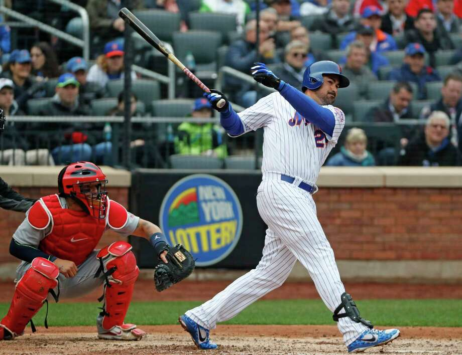 New York Mets' Adrian Gonzalez hits a fifth-inning RBI double in an opening day baseball game against the St. Louis Cardinals, Thursday, March 29, 2018, in New York. Cardinals catcher Yadier Molina is behind the plate. (AP Photo/Kathy Willens) Photo: Kathy Willens / Associated Press