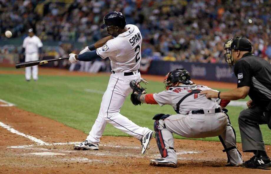 Tampa Bay Rays' Denard Span (2) connects for a three-run triple off Boston Red Sox relief pitcher Carson Smith during the eighth inning of a baseball game Thursday, March 29, 2018, in St. Petersburg, Fla. Red Sox catcher Christian Vazquez, second from right, looks on. (AP Photo/Chris O'Meara) Photo: Chris O'Meara / Copyright 2018 The Associated Press. All rights reserved.