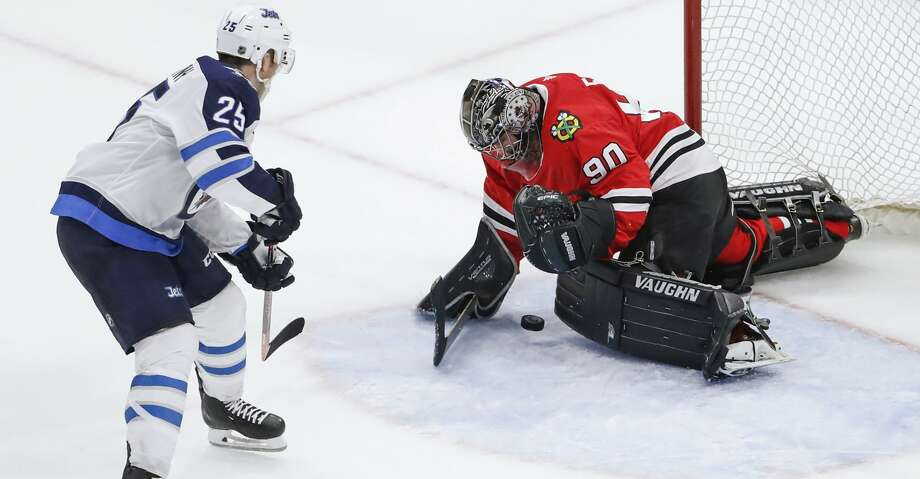 Chicago Blackhawks goalie Scott Foster (90) defends against Winnipeg Jets center Paul Stastny (25) during the third period of an NHL hockey game Thursday, March 29, 2018, in Chicago. (AP Photo/Kamil Krzaczynski) Photo: Kamil Krzaczynski/Associated Press