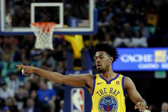 Quinn Cook (4) reacts after hitting a three pointer in the first half as the Golden State Warriors played the Milwaukee Bucks at Oracle Arena in Oakland, Calif., on Thursday, March 29, 2018.