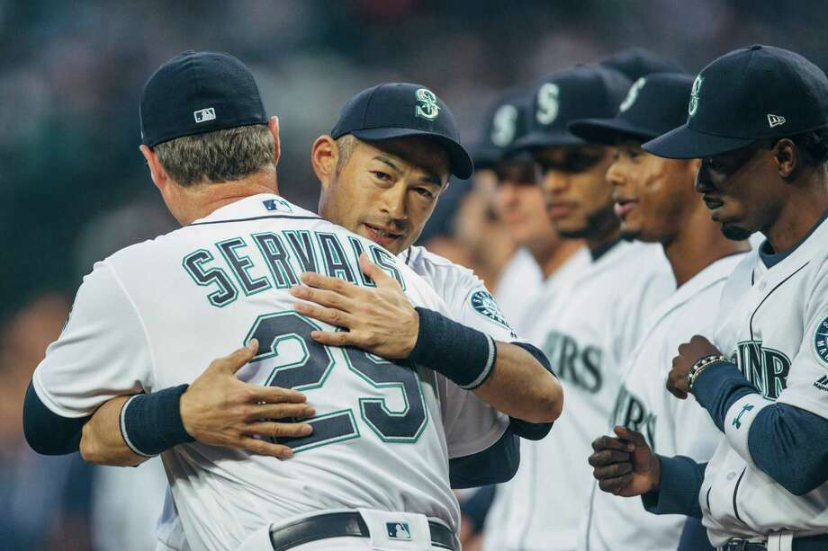 Mariners outfielder Ichiro Suzuki hugs manager Scott Servais after being announced before the team's season opener against Cleveland, at Safeco Field on Thursday, March 29, 2018. Photo: GRANT HINDSLEY, SEATTLEPI.COM / SEATTLEPI.COM