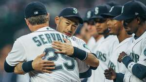 Mariners outfielder Ichiro Suzuki hugs manager Scott Servais after being announced before the team's season opener against Cleveland, at SafeCo Field on Thursday, March 29, 2018.