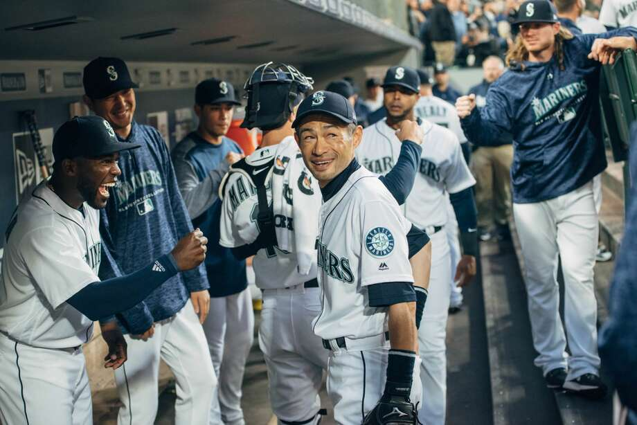 Famed hitter and returned Mariner Ichiro Suzuki smiles in the dugout before the Mariners take to the field for the first inning of their 2018 season, at Safeco Field on Thursday, March 29, 2018.(GRANT HINDSLEY, seattlepi.com) Photo: GRANT HINDSLEY/SEATTLEPI.COM
