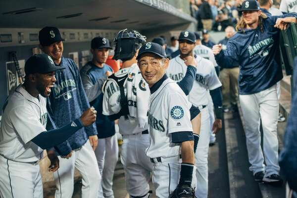 Famed hitter and returned Mariner Ichiro Suzuki smiles in the dugout before the Mariners take to the field for the first inning of their 2018 season, at SafeCo Field on Thursday, March 29, 2018.(GRANT HINDSLEY, seattlepi.com)