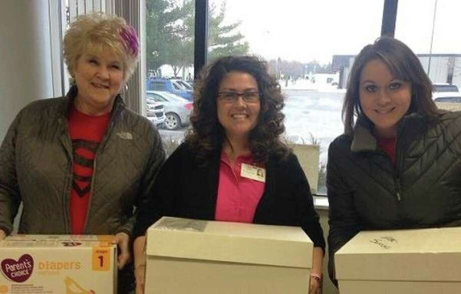 The Sandusky Branch of Eastern Michigan Bank recently hosted a supply drive for the Sanilac County Baby Pantry. Pictured are, from left, Rita Berberich, Jen Gezequel, coordinator for the Sanilac Child Abuse Prevention Council, and Alicia Reinke. (Submitted Photo)