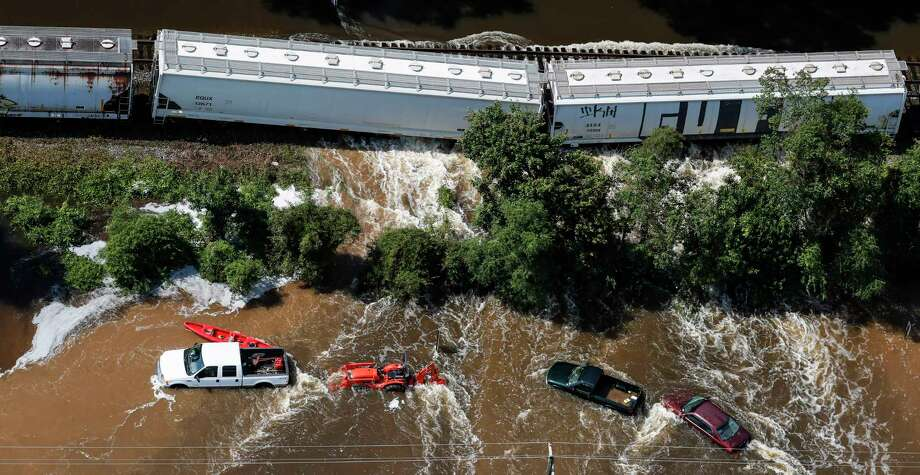 Water pushes a train off its tracks in, pushed by floodwaters of Tropical Storm Harvey, on Friday, Sept. 1, 2017, near Vidor, Texas. ( Brett Coomer / Houston Chronicle ) Click through to see photos of the devastating flooding across SE Texas during Harvey. Photo: Brett Coomer, Staff / © 2017 Houston Chronicle