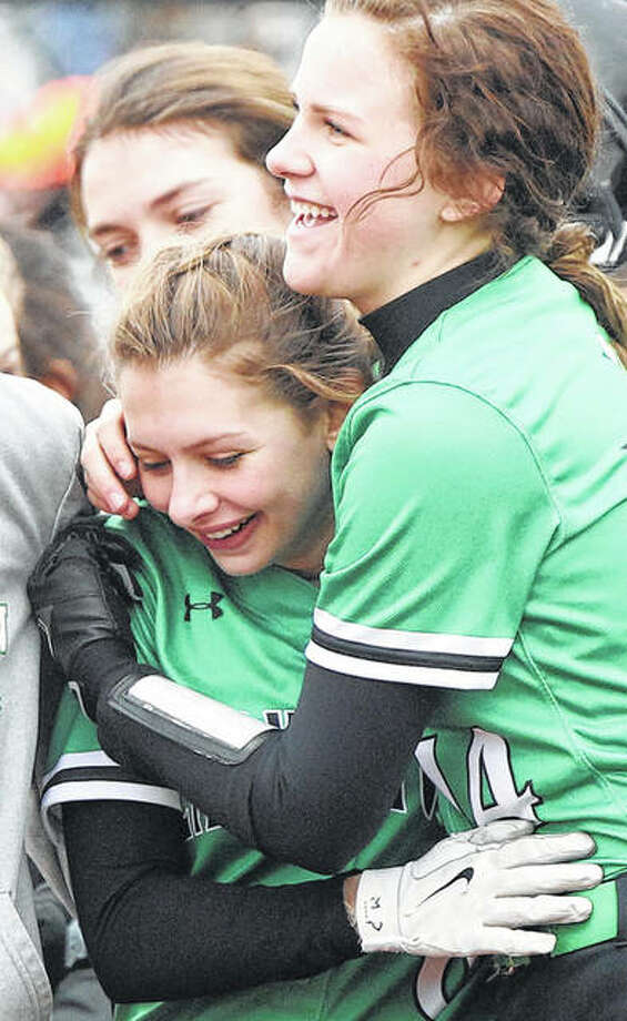 Carrollton's Kennedy Ruyle gets a hug from teammate Cameryn Varble (right) after Ruyle singled home the game-winning run in the eight inning to give the Hawks a 3-2 victory over Greenfield on Thursday at Lenz Field in Jacksonville. Photo: Dennis Mathes / Hearst Newspapers