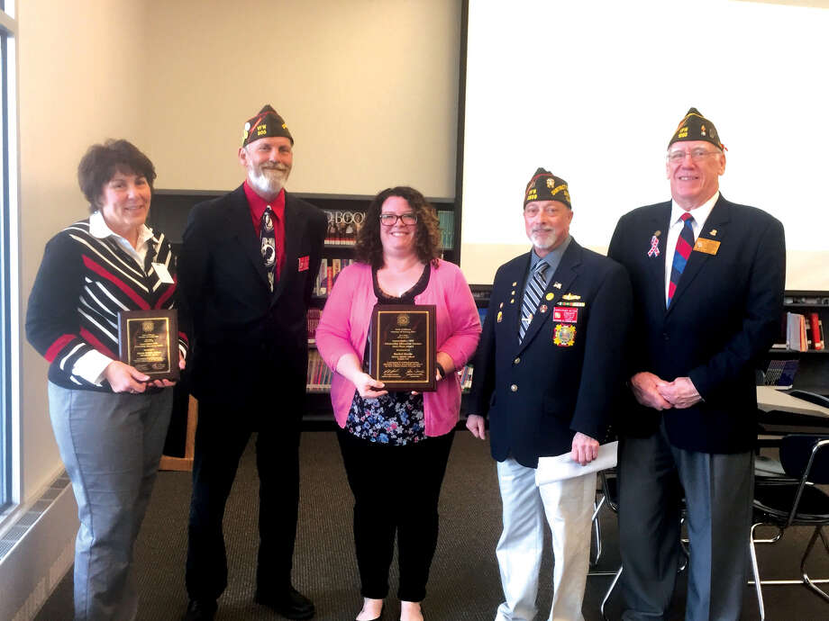 From left are: Beth Crumbacher, Liberty Middle School Principal; Jeff Hastings, VFW State Commander; honored teacher Rachel Harris; Chris Retzer, VFW District 12 Commander and and Larry Miller, VFW Post 1299 Commander. Photo: Julia Biggs • Jbiggs.edwi@gmail.com