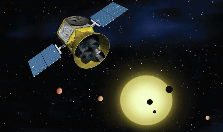 NASA's Transit Exoplanet Survey Satellite (TESS), shown here in a conceptual illustration, identifies exoplanets orbiting the brightest stars just outside our solar system. Photo: NASA. / Bloomberg